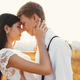 Loving couple dressed in white, ready to kiss outdoors with clos - PhotoDune Item for Sale