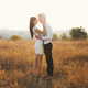 Loving couple dressed in white kissing outdoors, touching, gentl - PhotoDune Item for Sale