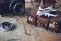 Toy plane and suitcase on vintage map with copy space, Travel concept - PhotoDune Item for Sale