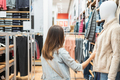 Young asian woman choosing clothes in clothing store at the mall, woman shopping lifestyle concept - PhotoDune Item for Sale