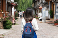 Young woman traveler walking at lijiang old town in Yunnan province, China - PhotoDune Item for Sale