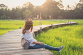 Young woman traveler looking at beautiful green paddy field - PhotoDune Item for Sale