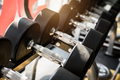 Rows of dumbbells on a rack in a gym - PhotoDune Item for Sale