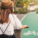 Young woman riding bicycle on bike lane in the park - PhotoDune Item for Sale
