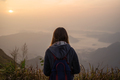 Young woman traveler looking at sunrise - PhotoDune Item for Sale