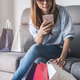 Happy asian woman holding credit card and smart phone - PhotoDune Item for Sale