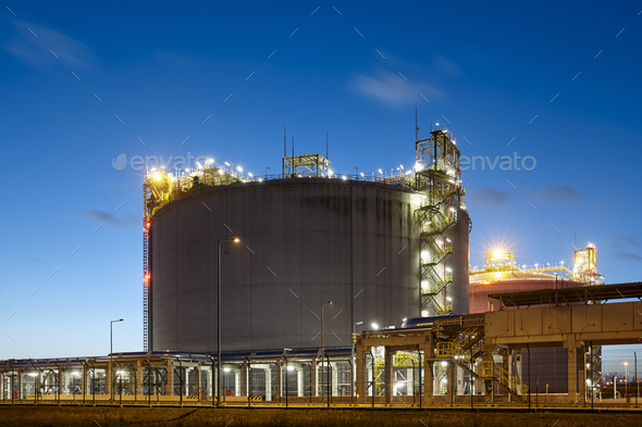 Liquefied natural gas storage tank at dusk. - Stock Photo - Images