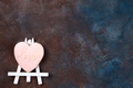 Cookies in the form of a heart in the icing on the easel as a picture on stone with copy space, flat - PhotoDune Item for Sale