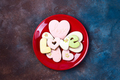 top view of glazed heart shaped cookies on red plate isolated on stone, flat lay. Happy Valentines - PhotoDune Item for Sale