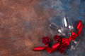 Background of Valentines day celebration with two glasses, roses and red ribbon on stone background - PhotoDune Item for Sale