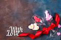 Two glass of wine, hearts and gift box on stone background. Romantic still life. Valentine's Day - PhotoDune Item for Sale