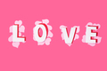 Word Love with hearts on a pink background. Valentine's Day - PhotoDune Item for Sale