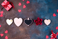 Valentines day background with handmaded hearts, cookies and gift box on a stone background - PhotoDune Item for Sale