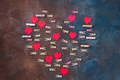red hearts and clothespins made heart isolated on stone background - Valentine's day concept - PhotoDune Item for Sale