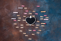 beautiful heart made of clothespins with a chalk board and space for text on stone background - - PhotoDune Item for Sale