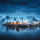 Winter landscape with houses, illumination, snowy mountains, sea - PhotoDune Item for Sale