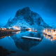 Village with boats on the sea at night and snowy mountains - PhotoDune Item for Sale