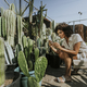 Woman taking photos of cacti at a botanical garden - PhotoDune Item for Sale