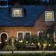 Beautiful red brick house with decorative lights - PhotoDune Item for Sale