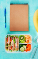 School lunch box with sandwich, vegetables, water, and fruits on table. - PhotoDune Item for Sale