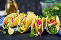 Mexican tacos with chicken meat, avocado, tomato, cucumber and red onion.  - PhotoDune Item for Sale