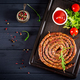Baked homemade sausage on a wooden board. Thanksgiving Day. Top view. - PhotoDune Item for Sale