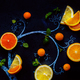 Lemon tea chalk tree with teacups, oranges and lemon slices, mint leaves and kumquats. Hot drink - PhotoDune Item for Sale