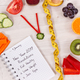 Goals for new year 2019 in notepad and fruits with vegetables in shape of clock - PhotoDune Item for Sale