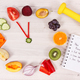 Clock made of fruits and vegetables, dumbbell and centimeter - PhotoDune Item for Sale