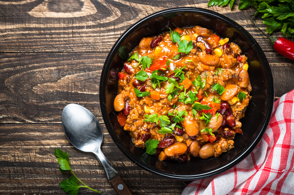 Chili con carne from meat and vegetables on wooden table top vie - Stock Photo - Images
