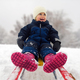 Childhood, sledding, leisure concept. Parent carrying happy little kid on sled in winter - PhotoDune Item for Sale