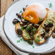 Close view of poached egg with wild mushrooms and toasted bread - PhotoDune Item for Sale