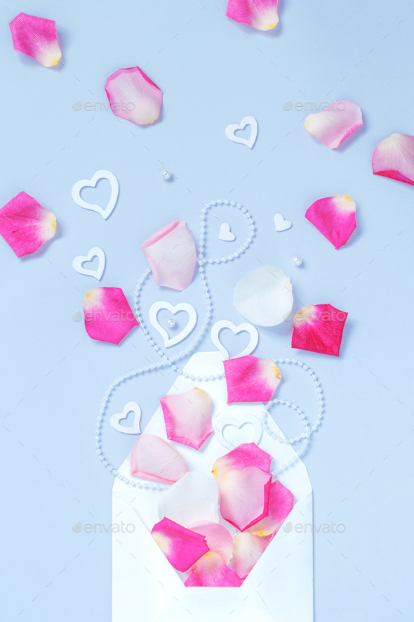 Envelope with petals and hearts - Stock Photo - Images