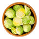 Fresh Brussels sprouts in wooden bowl over white - PhotoDune Item for Sale