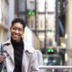 Close up of a millennial black businesswoman standing on a street in London smiling to camera - PhotoDune Item for Sale