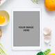 Digital touch screen tablet with fresh vegetables and kitchen utensils on background, top view - PhotoDune Item for Sale