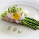 Poached egg over green asparagus on a plate - PhotoDune Item for Sale