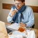 Sick man while working in office, businessman caught cold, seasonal flu. - PhotoDune Item for Sale