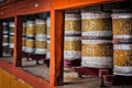 Buddhist prayer wheels in Hemis monstery, Ladakh - PhotoDune Item for Sale