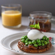 Wholemeal Bread Toast with Poached Egg and Peas. Orange Juice and onion jam on background - PhotoDune Item for Sale