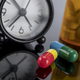 pills next to a clock, conceptual image - PhotoDune Item for Sale