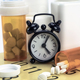 Pills on a calendar next to a clock, conceptual image - PhotoDune Item for Sale