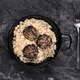 vertical shot of stewed rice with blood sausage on a dark marbled background - PhotoDune Item for Sale