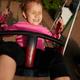 Little girl with funny facial expression swinging on the swings - PhotoDune Item for Sale