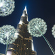 Burj Khalifa in the night against of luminous dandelions. - PhotoDune Item for Sale
