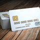 Stack of white blank credit cards mockup on  wooden table backgr - PhotoDune Item for Sale