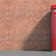 Red phone booth on brick wall background. London, british and en - PhotoDune Item for Sale