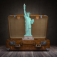 Statue of liberty and vintage suitcase. Travel and tourism  to N - PhotoDune Item for Sale