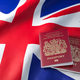 UK passport on the flag of the United Kingdom. Getting a UK pass - PhotoDune Item for Sale