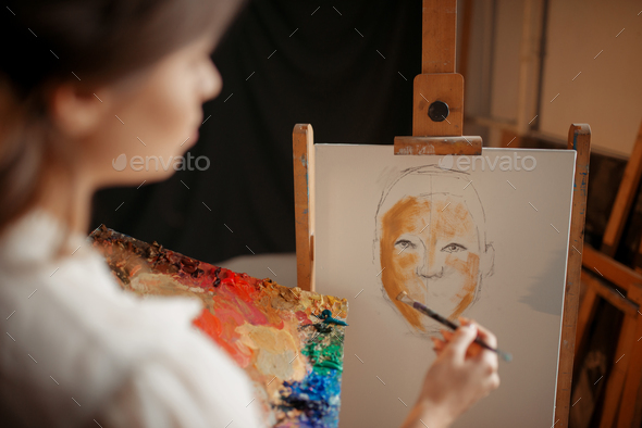 Female artist with color palette and brush - Stock Photo - Images